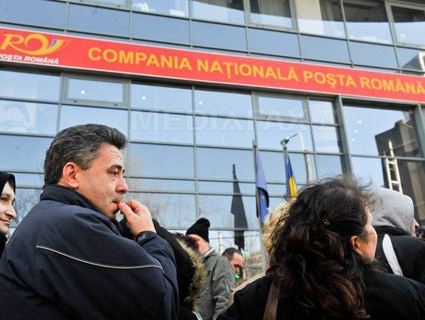 http://storage0.dms.mpinteractiv.ro/media/1/1/1686/9799231/1/posta-romana-protest-catalin-abagiu.jpg?width=600