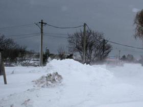 Mai multe localităţi din ţară, afectate de zăpadă şi de vântul puternic