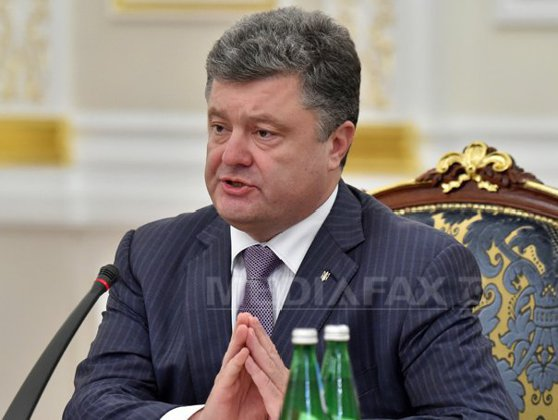 Imaginea articolului Petro Poroşenko ameninţă cu anularea armistiţiului după doborârea unui elicopter