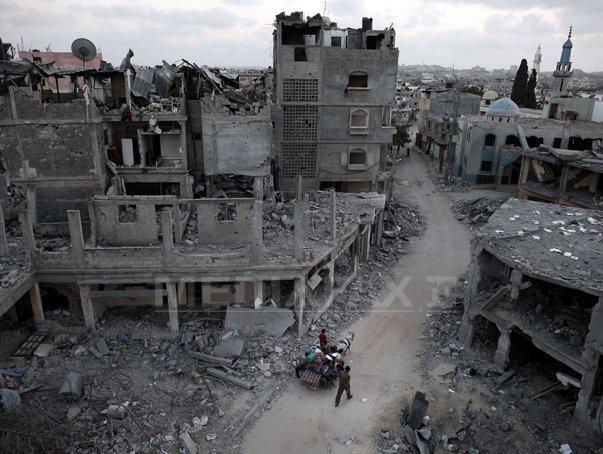 Palestinienii anunta un acord privind un ARMISTIŢIU permanent �n F�sia Gaza. Armistitiul va intra �n vigoare la ora 16.00 GMT