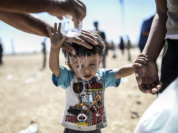 MEDIAFAX ZOOM: Refugiaţi din calea terorii - GALERIE FOTO