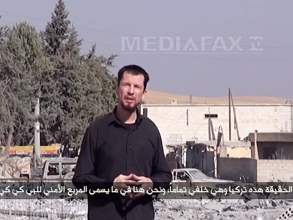 Gruparea SI difuzeaza o noua �nregistrare video cu ostaticul britanic John Cantlie