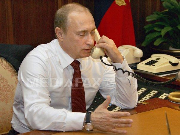 Putin, Hollande si Merkel au discutat la telefon despre negocierile de la Minsk