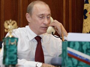 Vladimir Putin a discutat cu preşedintele Traian Băsescu despre problema gazelor (Imagine: Mediafax Foto/AFP)