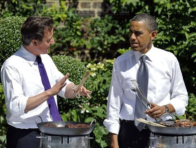 25 may obama and cameron serving sausages to soldiers at for What to serve at a bbq birthday party
