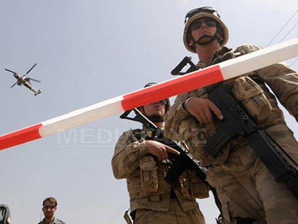 http://storage0.dms.mpinteractiv.ro/media/1/1/3614/9658370/1/afganistan-militari-nato.jpg?width=600