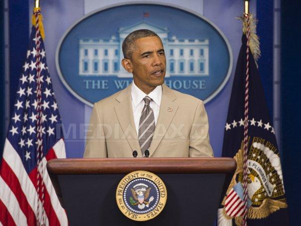Un costum purtat de Obama st�rneste v�lva pe retele de socializare - FOTO