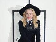 Madonna a dezvăluit că a fost în patul lui Donald Trump, atunci când a pozat pentru o revistă