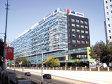 Trei giganţi din imobiliare s-au calificat în ultima rundă de negocieri pentru achiziţia birourilor America House din Bucureşti