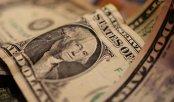 Dolarul, prins în războiul dintre Fed şi Donald Trump