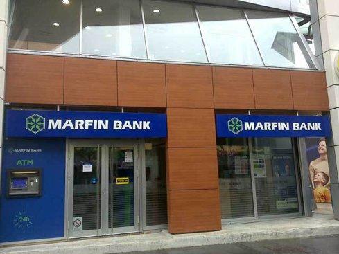 Duet Private Equity de la Londra, având susţinerea familiei Vardinogiannis, a mai făcut un pas spre preluarea Marfin Bank