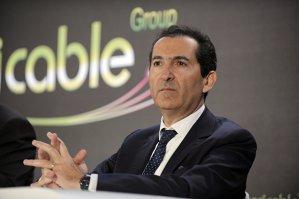 Faceţi cunoştinţă cu exoticul miliardar care devorează pe tăcute piaţa telecom din Europa
