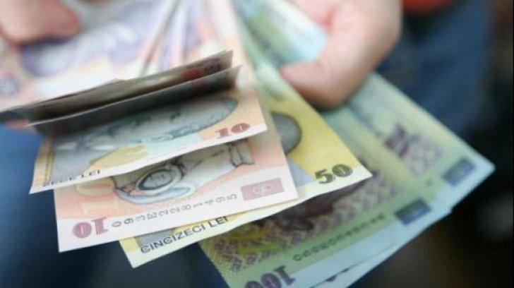 Un salariu pe zi în România. Cât câştigă un specialist în achiziţii