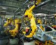 Industria îşi reduce ritmul de creştere, semn că economia încetineşte