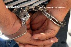 Şofer arestat după ce a a scuipat şi a vrut să dea cu maşina peste un poliţist