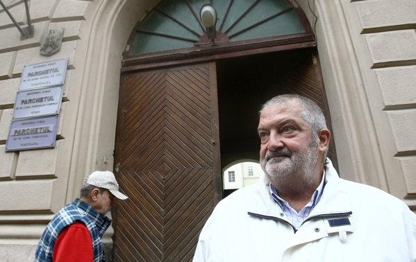 Gheorghe Ciuhandu, ieşind de la o audiere în 2014