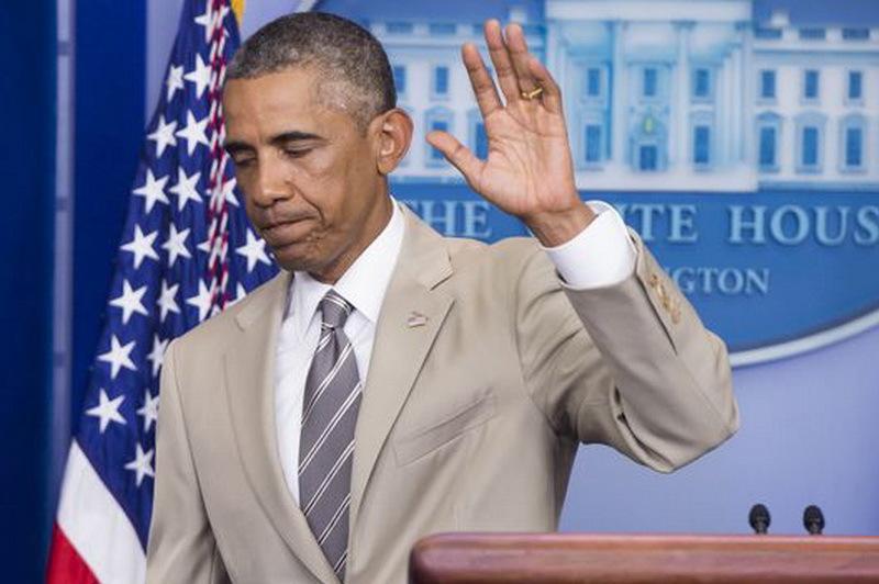 Costumul bej purtat de Obama st�rneste v�lva pe retele de socializare