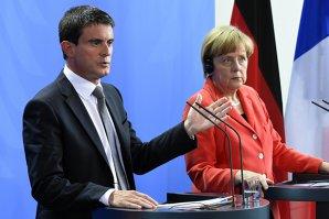 Noi probleme pentru Merkel: Franţa se opune sistemului de cote obligatorii privind repartizarea refugiaţilor în UE