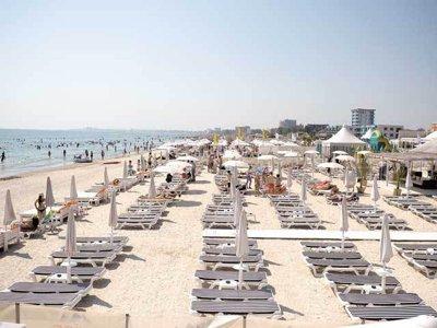 Klaus Iohannis a promulgat Legea privind acordarea voucherelor pentru vacanţă. În ce condiţii poţi beneficia de ele