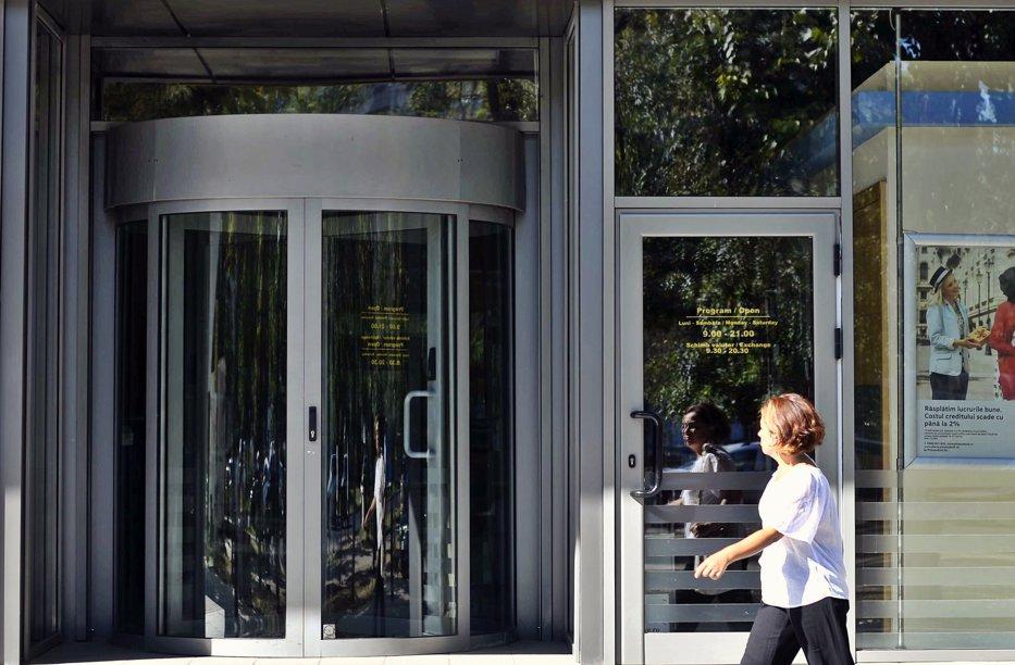 O bancă din România, cumpărată de americani, după un an de negocieri