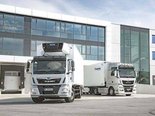 Transportatorii români solicită daune de 520 milioane de euro de la marii producători de camioane