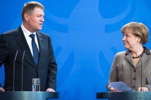 Cum explică preşedintele Iohhanis cancelarului Merkel ce se întâmplă în România