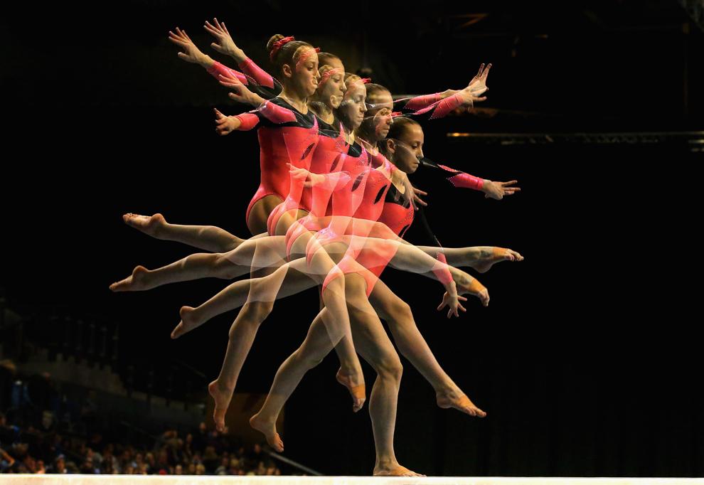 (NOTĂ: Imagine cu expunere multiplă) Millie Kennard de la Tolworth evoluează la finala pe aparate a Campionatului Marii Britanii de Gimnastică, la Echo Arena, în Liverpool, duminică, 24 martie 2013.
