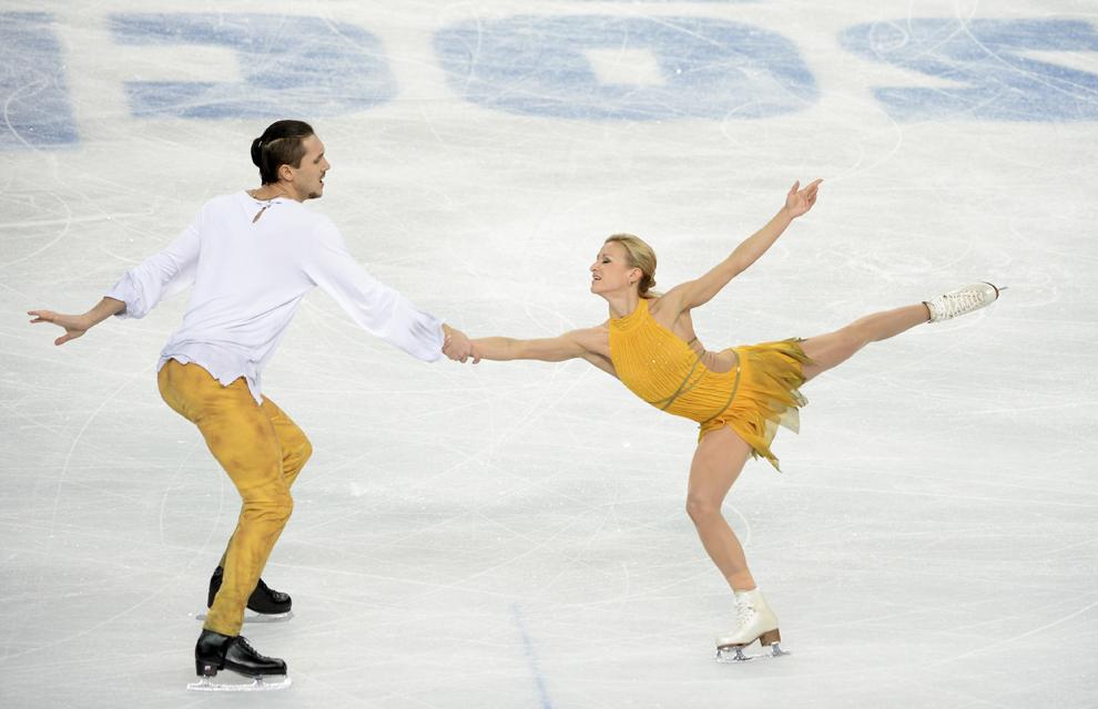 Tatiana Volosozhar şi Maxim Trankov, Rusia, concurează în proba de patinaj artistic - program liber din cadrul Jocurilor Olimpice de Iarnă, în Soci, miercuri, 12 februarie 2014.
