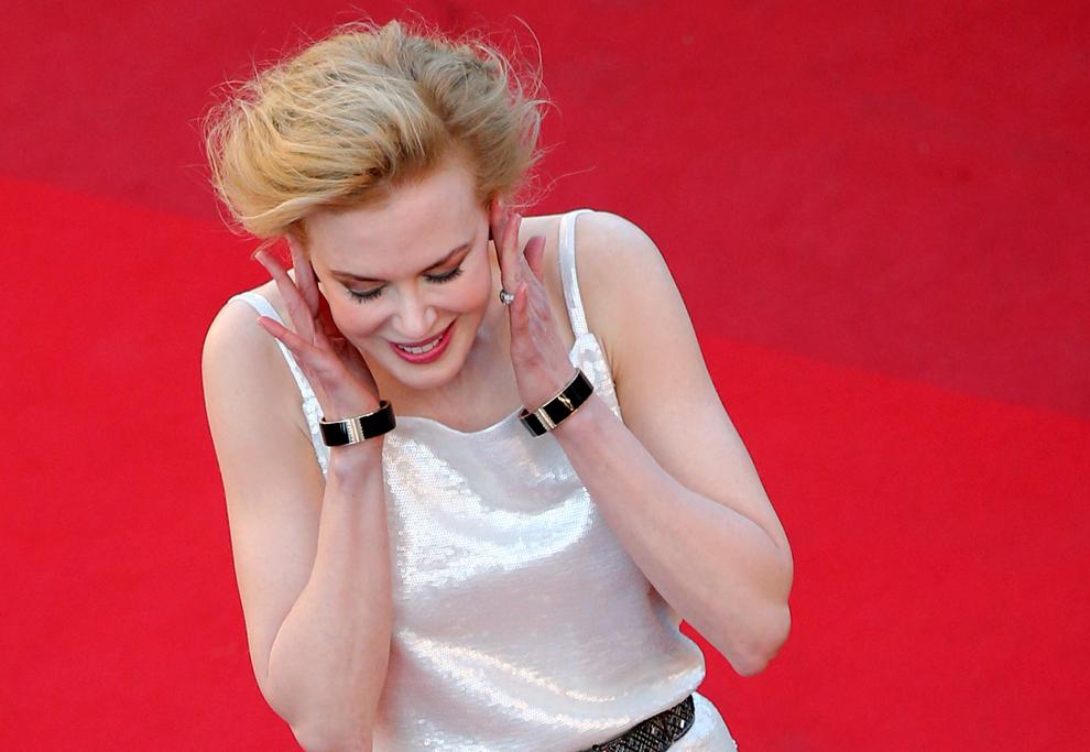 Actriţa australiană şi membră a juriului secţiunii Film de lung metraj, Nicole Kidman, pozează în timp ce soseşte la proiecţia filmului 'Venus in Fur', prezentat în cadrul competiţiei celei de-a 66-a ediţii a Festivalului de Film de la Cannes, în Cannes, sâmbătă, 25 mai 2013.