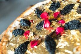 O pizza pe Wall Street şi un preţ pe măsură: 2000 de dolari