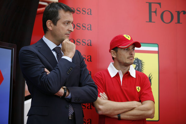 Giancarlo Fisichella si Enrico Galliera, Senior Vice President Commercial & Marketing Ferrari