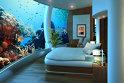 4. Apartamentul Poseidon: se află în staţiunea Poseidon Undersea din Fiji, iar preţul pentru o  cameră aici este de 30, 000 de dolari pentru un pachet de 6 nopţi/cuplu. Apartamentul se află la la 13 metri sub apă, iar o fereastră din sticlă specială ţine loc de pereţi pentru 70 la sută din cameră. Hotelul oferă şi o bibliotecă, un restaurant cu 100 de locuri, precum şi degustări de vin, expediţii SCUBA şi tratamente SPA – toate la pachet cu priveliştea pe care o oferă oceanul.