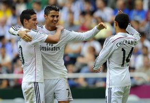 Real Madrid s-a impus cu emoţii la Sevilla, scor 2-3. Jucătorii lui Ancelotti rămân în coasta Barcelonei şi încă speră la titlu. Ce record incredibil a bătut Ronaldo