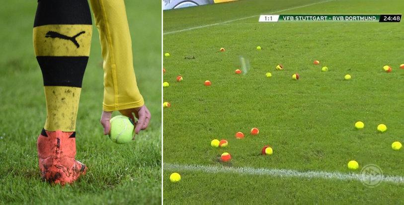 Imagini incredibile în Germania! Fanii Borussiei Dortmund au întrat pe stadion în minutul 20 şi au umplut terenul de mingi de tenis, la meciul cu Stuttgart! Motivul