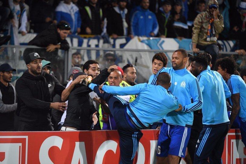 Patrice Evra a fost suspendat 7 luni de UEFA după ce a lovit cu piciorul în cap un suporter! UPDATE | Marseille i-a reziliat contractul