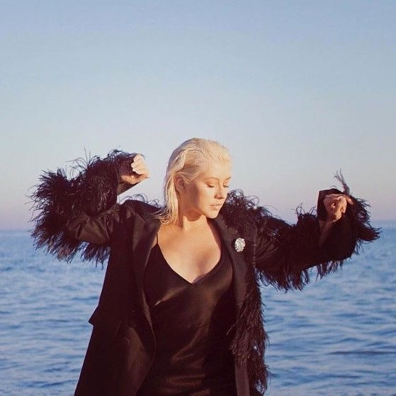 Aguilera, topless for cover for her new album. PHOTO