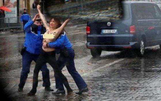 Imaginea articolului INCIDENT la Paris: O activistă a mişcării Femen s-a apropiat de convoiul în care se afla Trump/ N-a fost singura   VIDEO