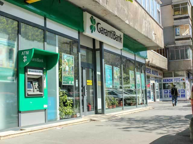 În timp ce negociază achiziţia Bancpost, Banca Transilvania se uită şi la Garanti Bank. UPDATE.Răspunsul Băncii Transilvania