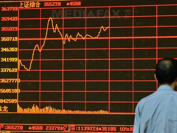 Capitalizarea Apple a urcat cu 50% în 2017 şi a dus indicele Dow Jones la noi maxime