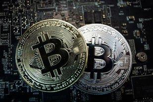 Moneda virtuala Bitcoin a depasit pentru prima data valoarea de 30.000 de dolari